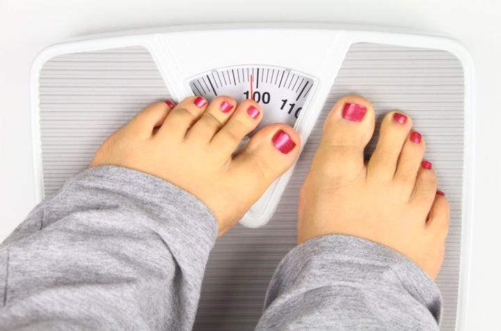 Избыточный вес - одна из причин вальгусной деформации